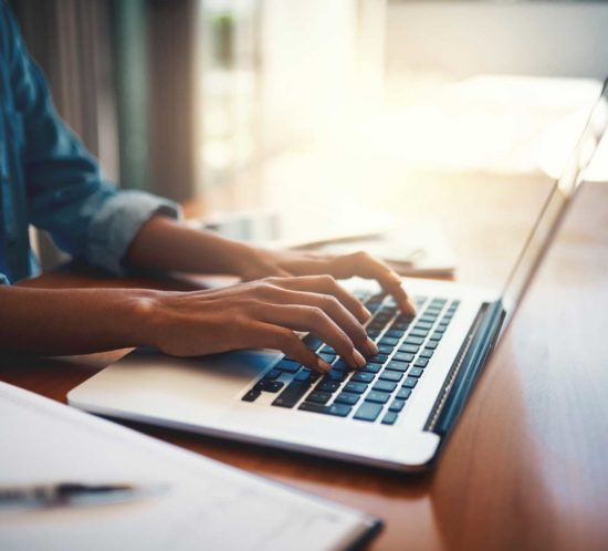 A woman using a laptop while working from home - Rockland Insurance Brokers